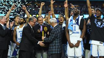 Apr 3, 2017; Phoenix, AZ, USA; North Carolina Tar Heels head coach Roy Williams is presented with the championship trophy after defeating the Gonzaga Bulldogs in the championship game of the 2017 NCAA Men's Final Four at University of Phoenix Stadium. Mandatory Credit: Bob Donnan-USA TODAY Sports