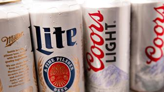 Cans of Molson Coors Brewing Co. Miller Lite and Coors Light brand beer are arranged for a photograph in a refrigerator in Princeton, Illinois, U.S., on Wednesday, Oct. 26, 2016. Molson Coors Brewing Co. is scheduled to release earnings figures on November 1. Photographer: Daniel Acker/Bloomberg via Getty Images