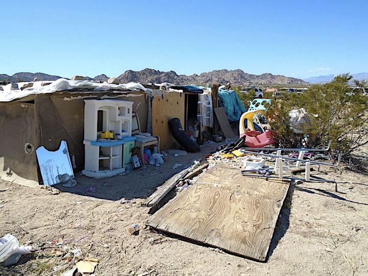 San Bernardino County sheriff's deputies founda family living in a plywood box that was four feet high with no el