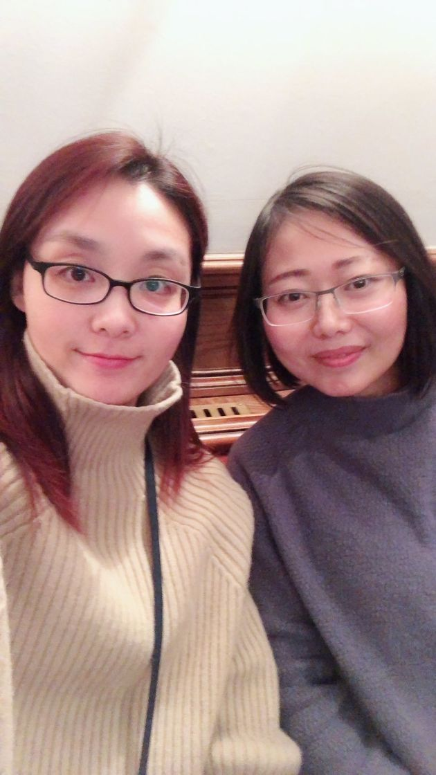 Serena Gao (right) and her friend Liya Xu slept at the pub overnight after being rescued from a stranded
