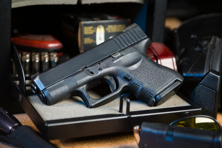 Ahandgun stored in a gun safe.
