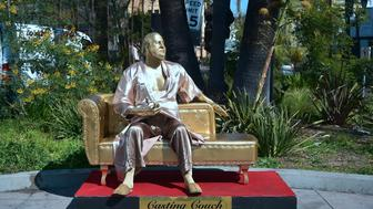 A gold sculpture of Harvey Weinstein on his infamous casting couch holding an Oscar statue is on display in Hollywood, California on March 1, 2018, where artists Plastic Jesus and Joshua Monroe displayed their creation days before the 90th Oscars Awards on Sunday, March 4. / AFP PHOTO / Frederic J. BROWN        (Photo credit should read FREDERIC J. BROWN/AFP/Getty Images)
