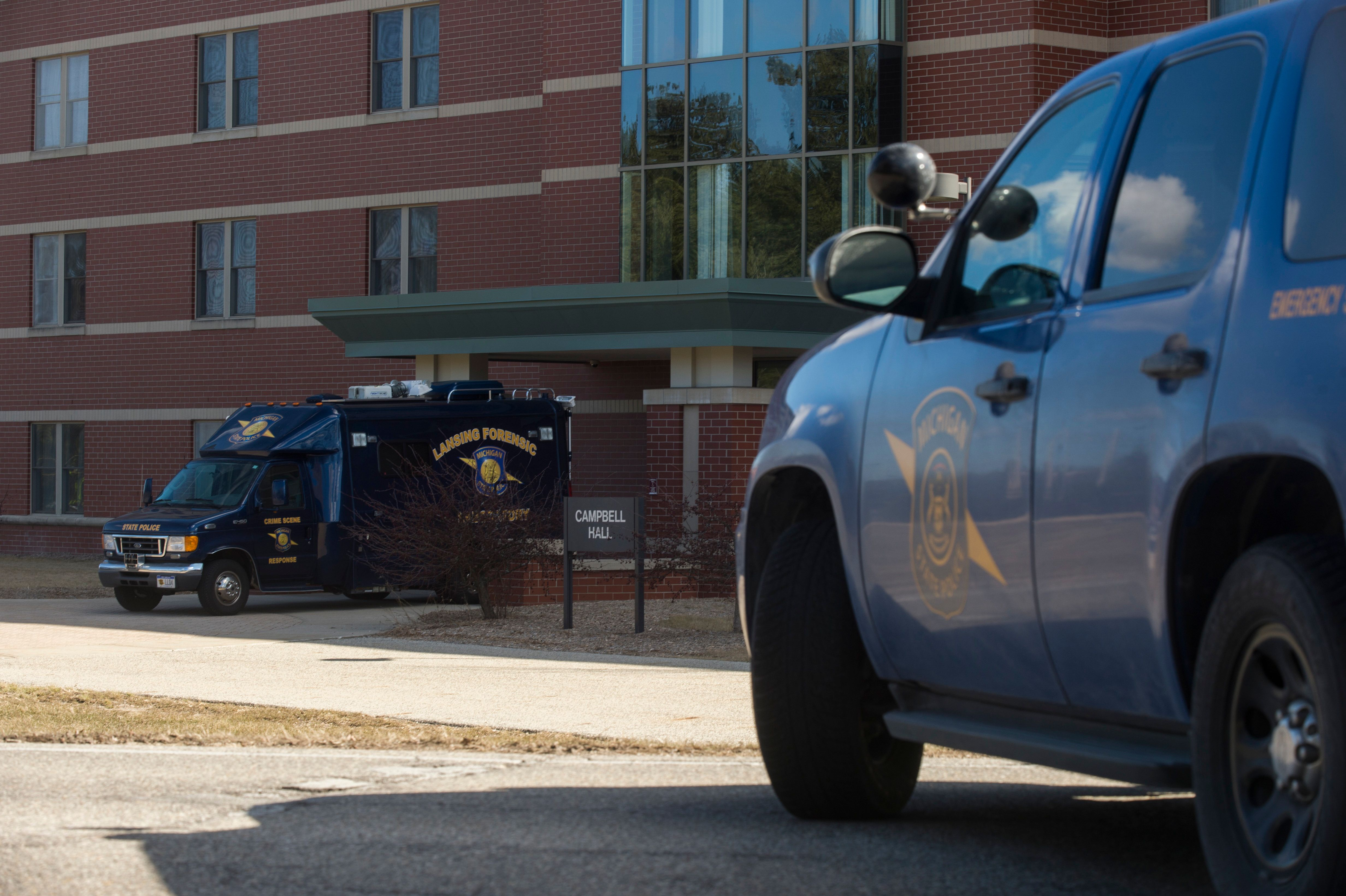 MOUNT PLEASANT, MI - MARCH 02: A Lansing Forensic Laboratory truck is parked outside of Campbell Hall, where a shooting took place at Central Michigan University on March 2, 2018 in Mount Pleasant, Michigan. Two people were killed in an on-campus shooting at Central Michigan University. The University is on lockdown as the police search for the suspect, a 19-year-old man. (Photo by Rachel Woolf/Getty Images)