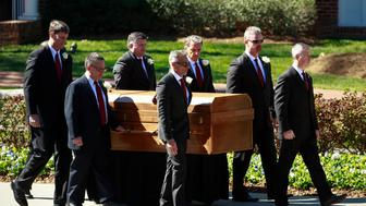 Pallbearers carry the casket of the late U.S. evangelist Billy Graham during Graham's funeral service at the Billy Graham Library in Charlotte, North Carolina, U.S. March 2, 2018. REUTERS/Chris Keane