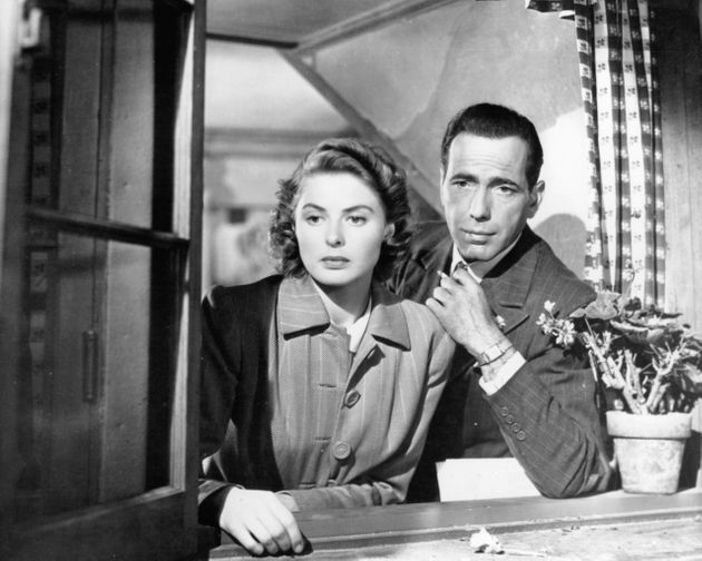 Ingrid Bergman and Humphrey Bogart look out a window in a scene from the 1942 film