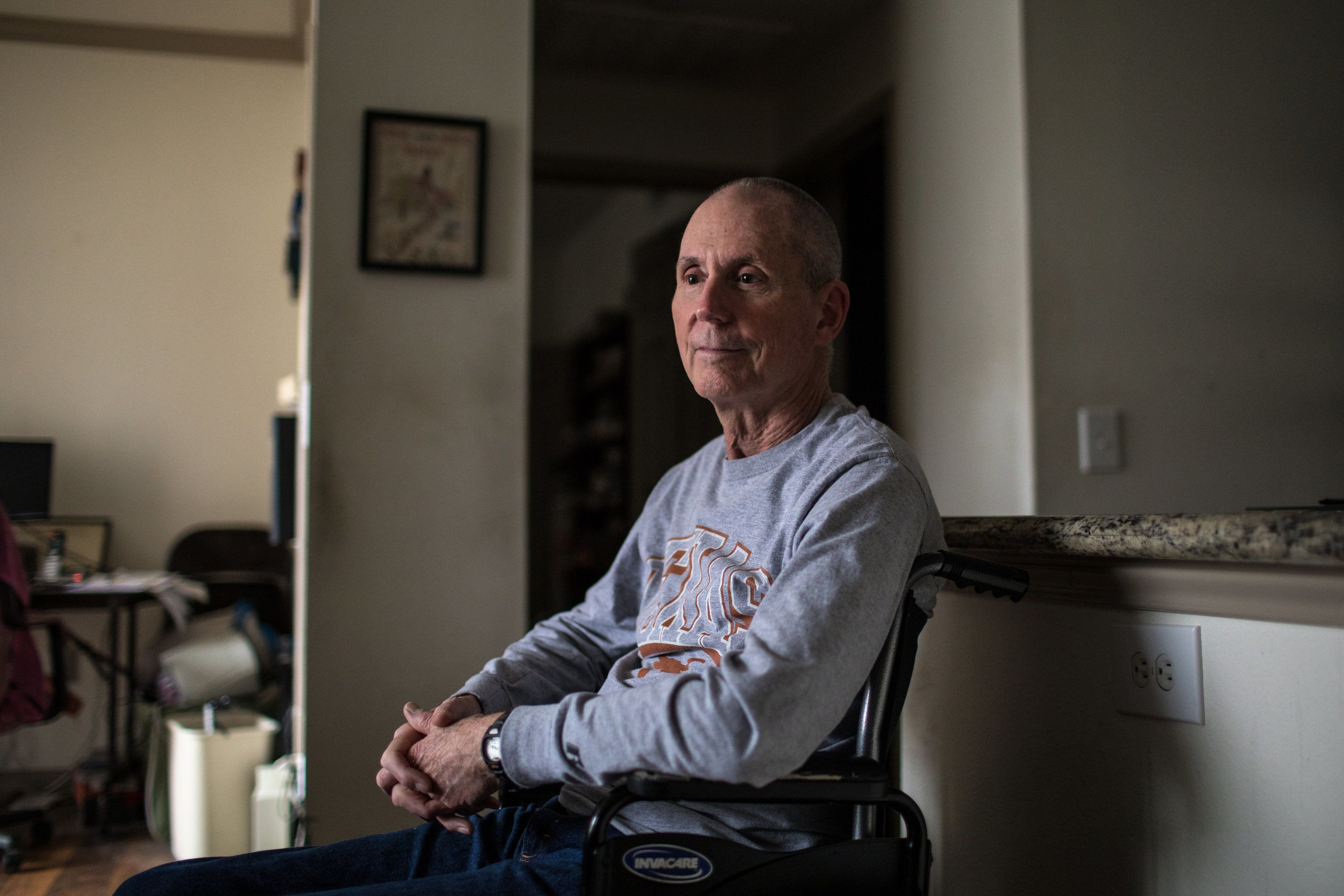 Chuck Yarling, 72, at his apartment in Austin, Tex. on Feb. 23, 2018. Yarling, a long-time triathlete who contracted West Nile virus in 2012, is determined to continue racing despite significant impairments to his mobility. (Tamir Kalifa for HuffPost)