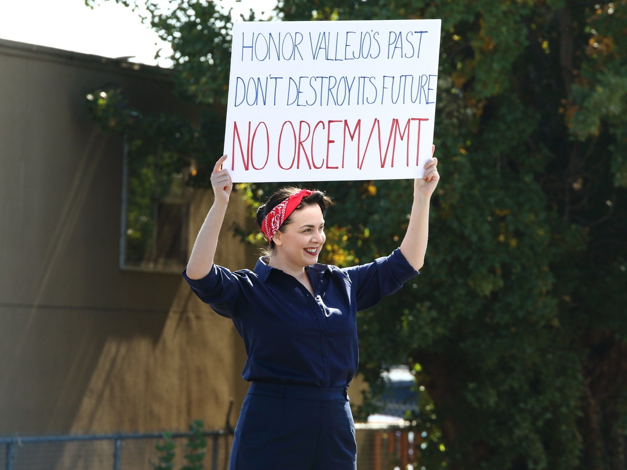 A protester holds up a banner at a rally in Vallejo, California, in October toopposethe proposedOrcem cemen