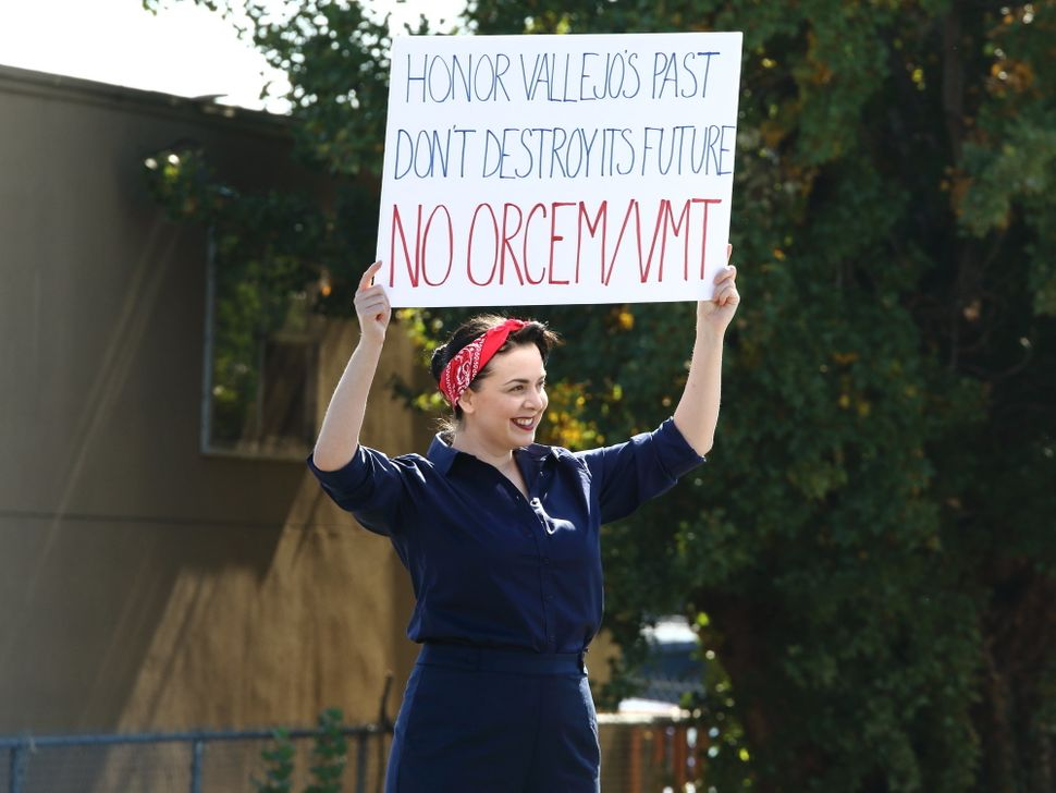 A protester holds up a banner at a rally in Vallejo, California, in October to oppose the proposed Orcem cemen