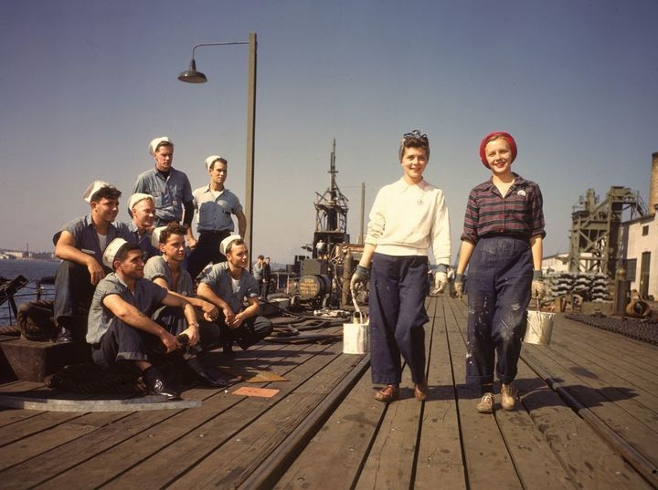 In 1943, sailors admire women workers at the Electric Boat Co. in New London, Conn., where submarines were built during World War II.