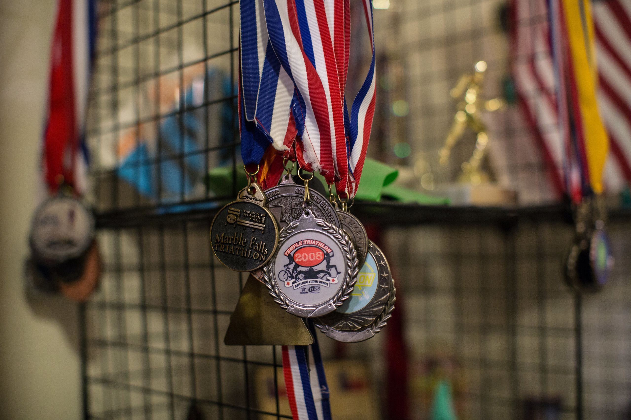Trophies, plaques, ribbons, medals and other mementos from Yarling's triathlon racing career are displayed at his home.