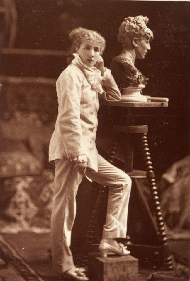 Actress Sarah Bernhardt wearing a trouser suit as she sculpts a self-portrait, in a photo from the late 19th century.