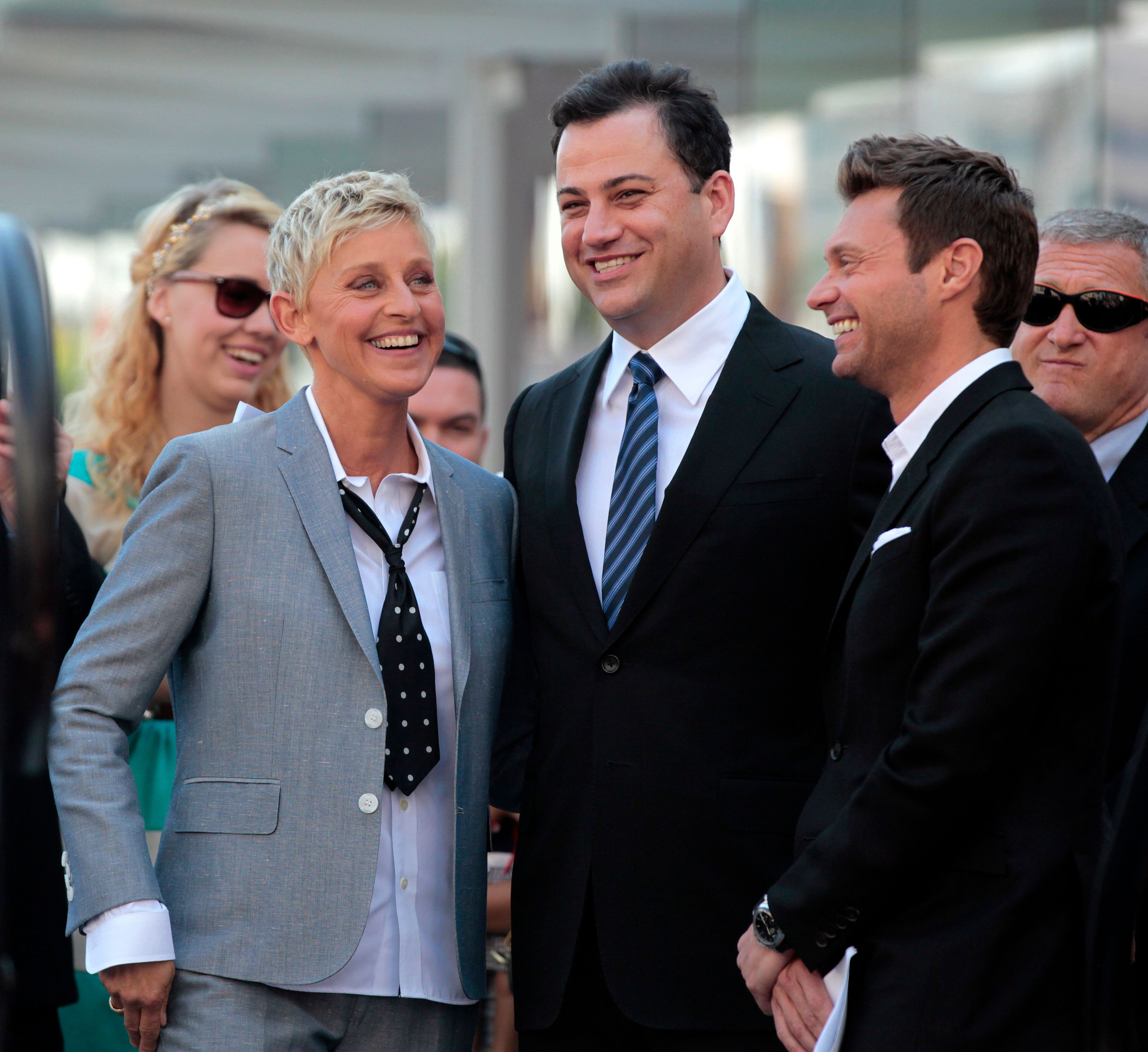 Television personality Ellen DeGeneres smiles with television hosts Jimmy Kimmel (C) and Ryan Seacrest before her star was unveiled on the Walk of Fame in Hollywood, California September 4, 2012. REUTERS/Mario Anzuoni (UNITED STATES - Tags: ENTERTAINMENT PROFILE)