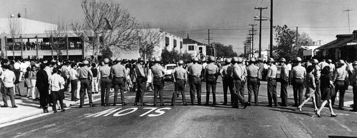 Sheriff's deputies form a line across street at Garfield High School in Los Angeles during a student demonstration on March 5