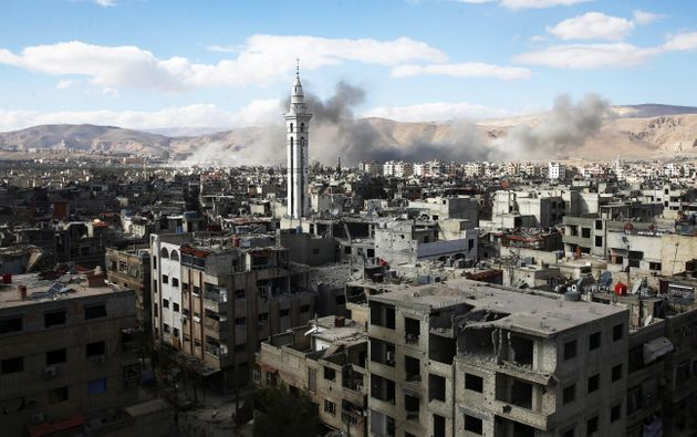 Smoke rises from besieged eastern Ghouta in Damascus, Syria, on Feb. 27,