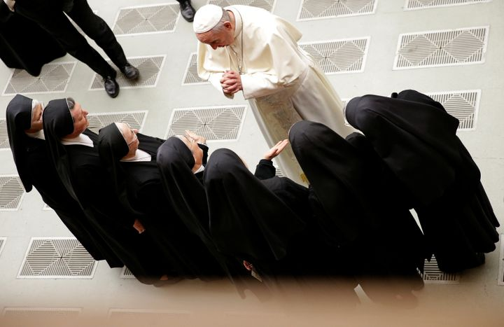 Pope Francis greets a group of nuns during the general audience in Paul VI hall at the Vatican December 20, 2017.
