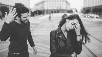 Young couple having a conflict at the street