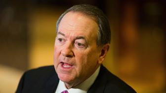 Former Arkansas governor Mike Huckabee speaks to the media at Trump Tower in New York City on November 18, 2016. / AFP / DOMINICK REUTER        (Photo credit should read DOMINICK REUTER/AFP/Getty Images)