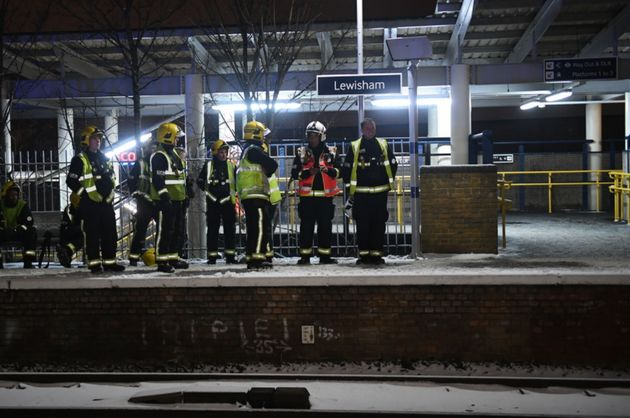 Emergency workers at Lewisham station after passengers frustrated by delays jumped from trains and walked down tracks near the station