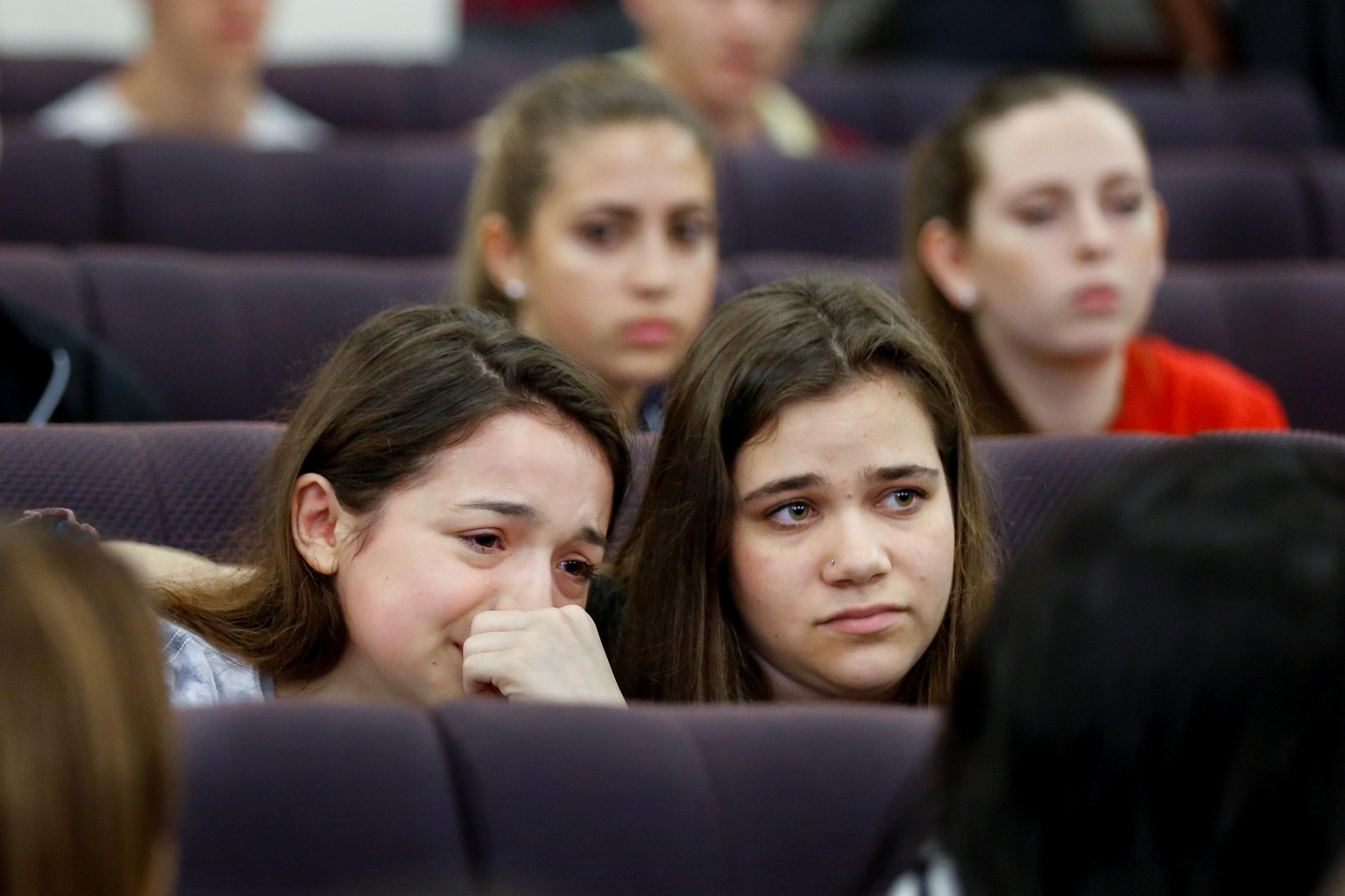 Marjory Stoneman Douglas High School student Alondra Gittelson (left) is comforted by schoolmate Bailey...