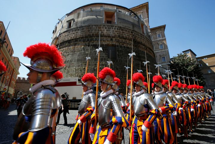 New recruits of theVatican's elite Swiss Guard march in front of the tower of the Institute for Works of Religion (IOR)