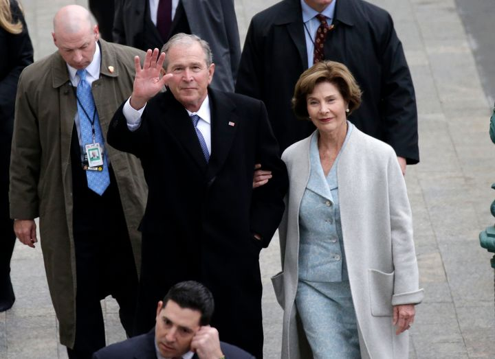 Former President George W. Bush and his wife, Laura Bush, arrive at the Capitol for the inauguration of Donald Trump last yea