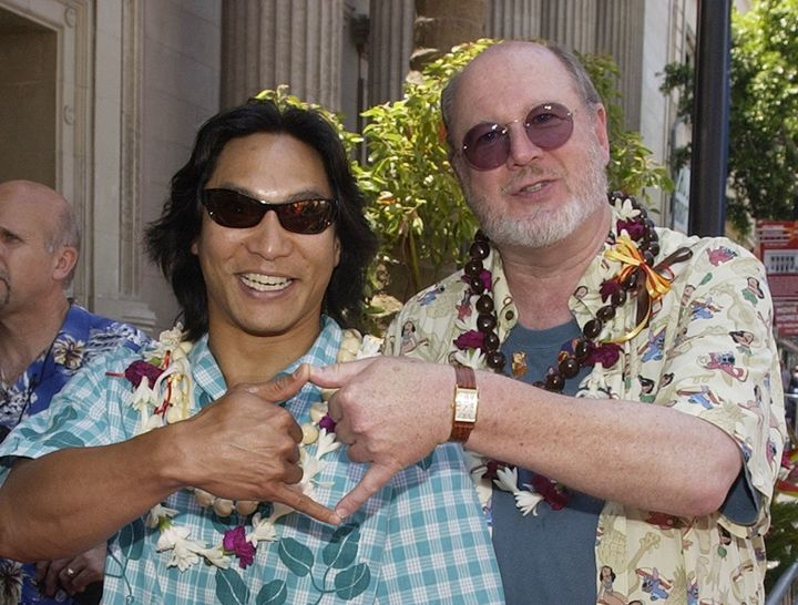 Actors Jason Scott Lee (L) and David Ogden Stiers, the voices of David Kawena and Jumba respectively in the animated motion p