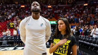The Miami Heat's Dwyane Wade stands next to Andrea Ghersi, the sister of Joaquin Oliver, 17, who was killed in the Marjory Stoneman Douglas High School shooting, during the singing of the national anthem before the Heat faced the Detroit Pistons at the AmericanAirlines Arena in Miami on Saturday, March 3, 2018. (Matias J. Ocner/Miami Herald/TNS via Getty Images)