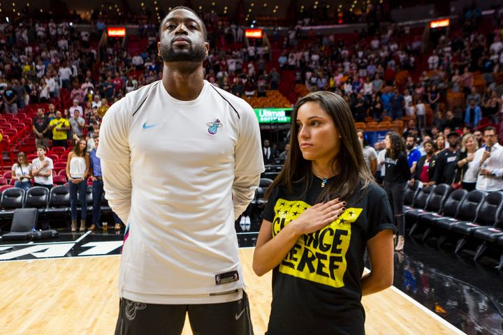 Dwyane Wade stands next to Andrea Ghersi, the sister of Joaquin Oliver, during the singing of the national anthem on Saturday