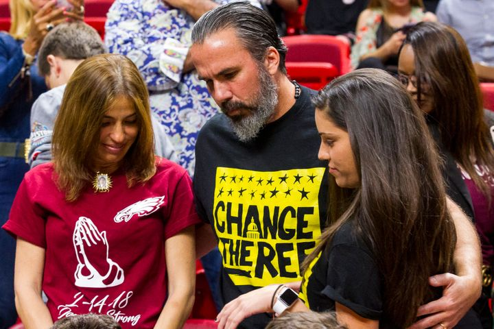 Joaquin Oliver's parents, Manuel and Patricia Oliver, attended Saturday's game with their daughter, Andrea Ghersi.