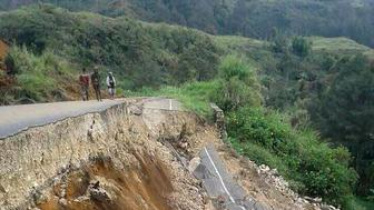 This photo taken on February 27, 2018 and received on February 28 shows damage to a road near Mendi in Papua New Guinea's highlands region after a 7.5-magnitude earthquake. Communication blackouts and blocked roads were hampering rescue efforts on February 28 as Papua New Guinea worked to get a better grasp of the damage wrought by a massive earthquake amid fears of its economic impact. / AFP PHOTO / Melvin LEVONGO        (Photo credit should read MELVIN LEVONGO/AFP/Getty Images)