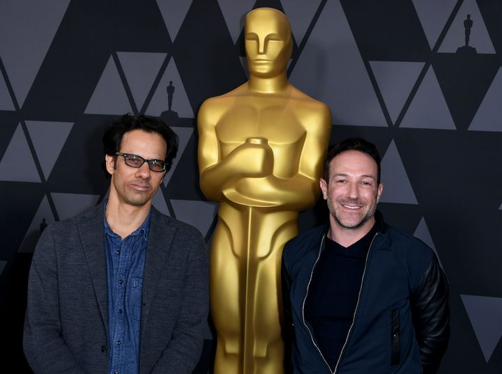 """Icarus"" directors Dan Cogan and Bryan Fogel arrive at a pre-Oscars reception."