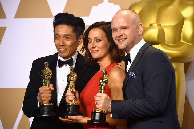 Make-up artists Kazuhiro Tsuji, Lucy Sibbick, and David Malinowski, winners of the Best Makeup and Hairstyling...