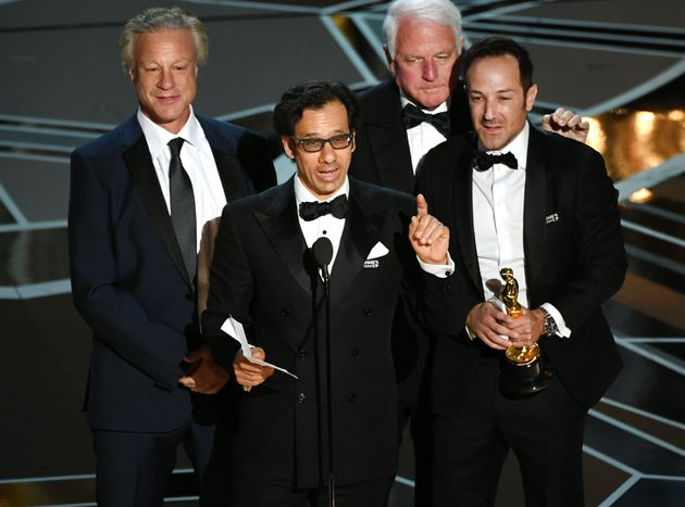 Producer David Fialkow, director Dan Cogan, producer James R. Swartz, and director Bryan Fogel accept...