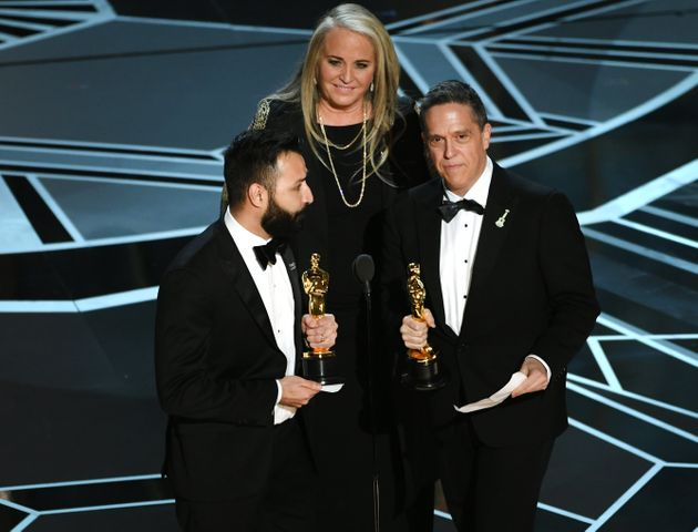 Filmmakers Adrian Molina, Darla K. Anderson and Lee Unkrich accept Best Animated Feature Film for 'Coco'...