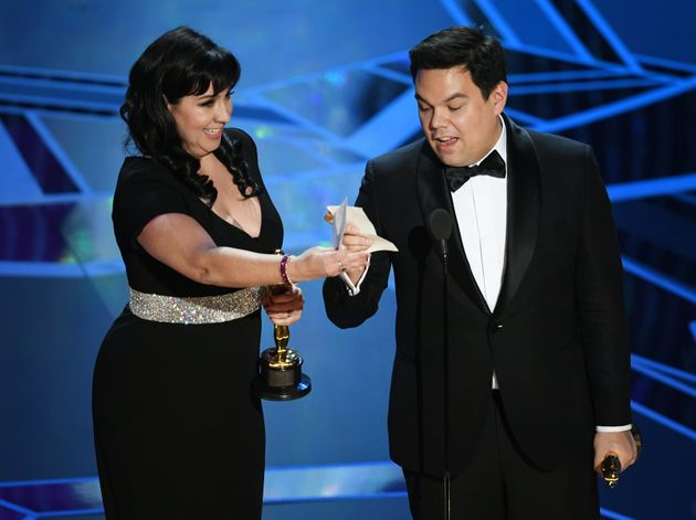 Songwriters Kristen Anderson-Lopez (L) and Robert Lopez accept Best Original Song for 'Remember Me' from...