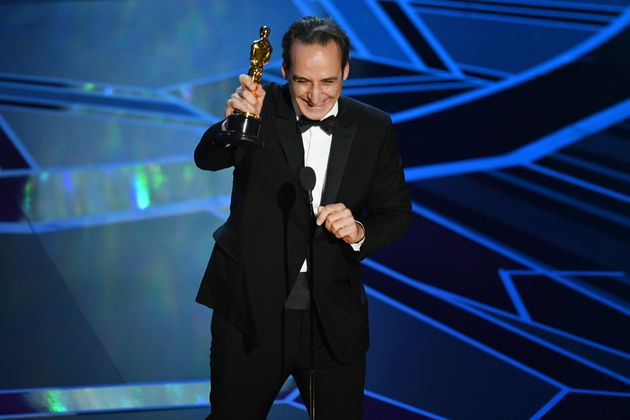 Composer Alexandre Desplat accepts Best Original Score for 'The Shape of Water' onstage during the 90th...