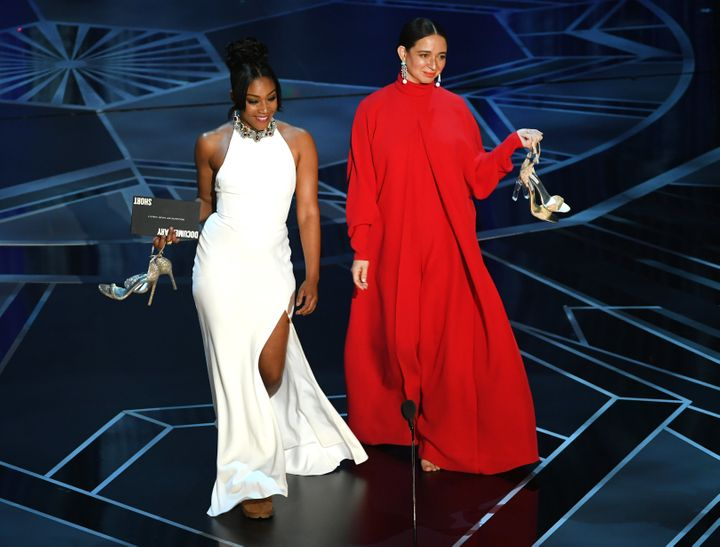 Actors Tiffany Haddish (left) and Maya Rudolph walk onstage during the 90th Annual Academy Awards.
