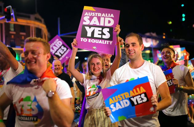 Participants hold banners regarding same-sex marriage during the 40th anniversary of the Sydney Gay and...