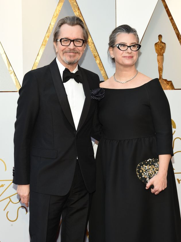 Gary Oldman and Gisele Schmidt arrive for the 90th Annual Academy