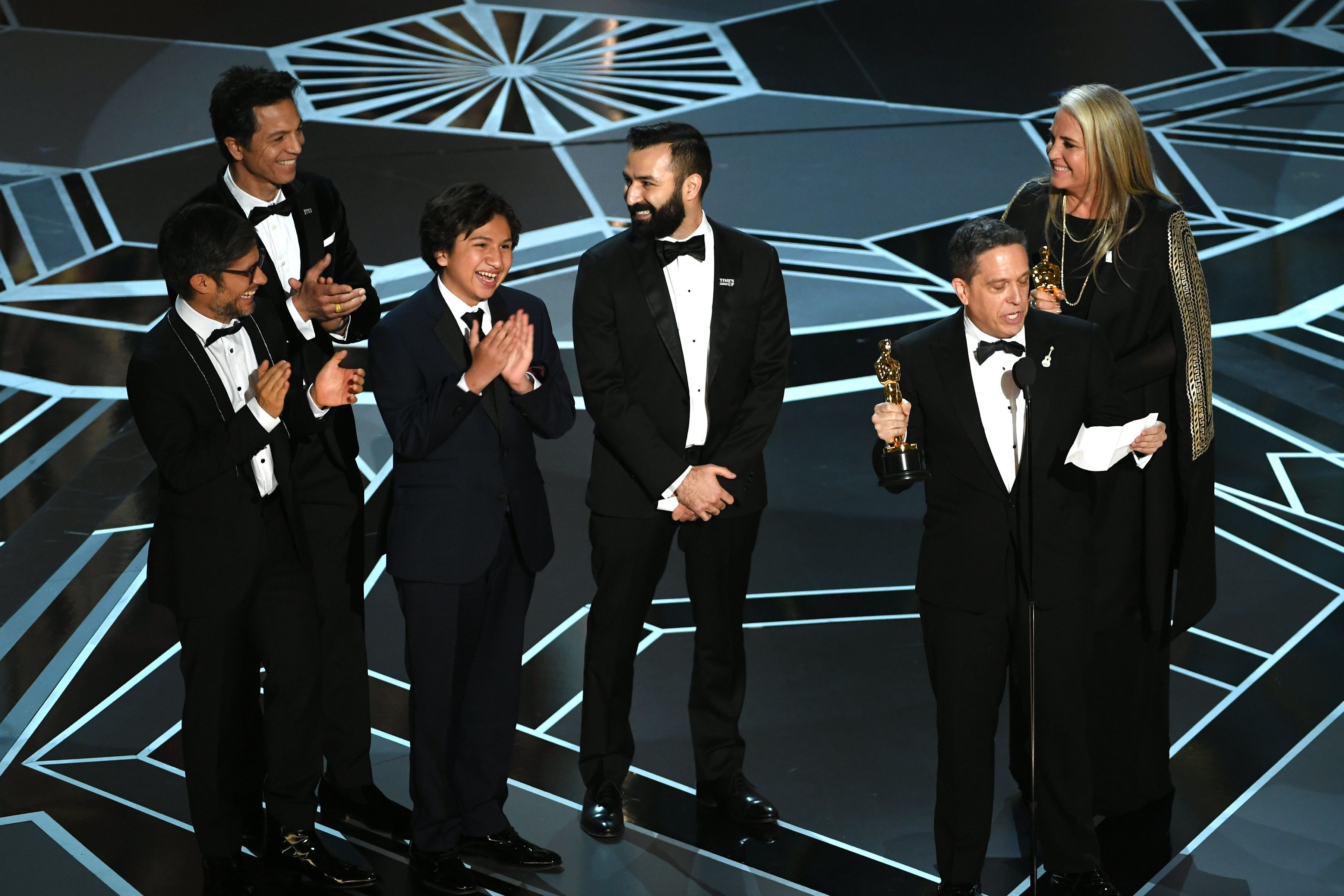 HOLLYWOOD, CA - MARCH 04:  (L-R) Actors Gael Garcia Bernal, Benjamin Bratt and Anthony Gonzalez, co-directors Adrian Molina and Lee Unkrich, and producer Darla K. Anderson accept Best Animated Feature Film for 'Coco' onstage during the 90th Annual Academy Awards at the Dolby Theatre at Hollywood & Highland Center on March 4, 2018 in Hollywood, California.  (Photo by Kevin Winter/Getty Images)