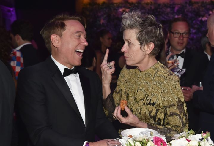Frances McDormand chats with talent agent Kevin Huvane at the Vanity Fair Oscar Party.