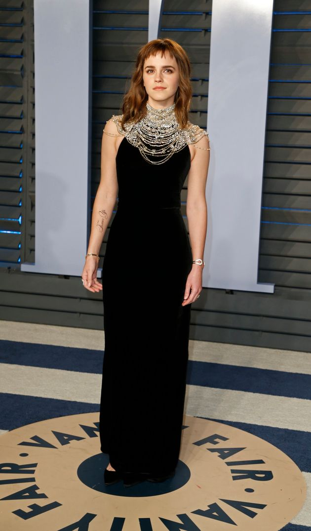 Emma Watson sports a temporary tattoo along with a Ralph Lauren gown at the Vanity Fair Oscar party on