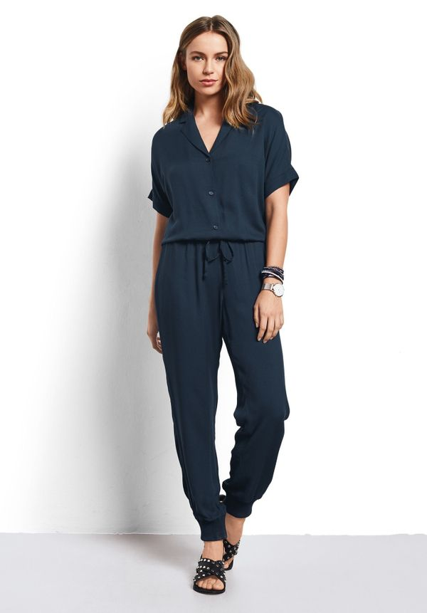 """Get it on <a href=""""https://www.hush-uk.com/womenswear/daywear/jumpsuits_playsuits/s_s_jumpsuit_blueberry.htm"""" target=""""_blank"""""""