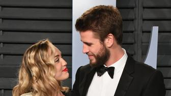 BEVERLY HILLS, CA - MARCH 04:  Miley Cyrus (L) and  Liam Hemsworth attend the 2018 Vanity Fair Oscar Party hosted by Radhika Jones at Wallis Annenberg Center for the Performing Arts on March 4, 2018 in Beverly Hills, California.  (Photo by Jon Kopaloff/WireImage)