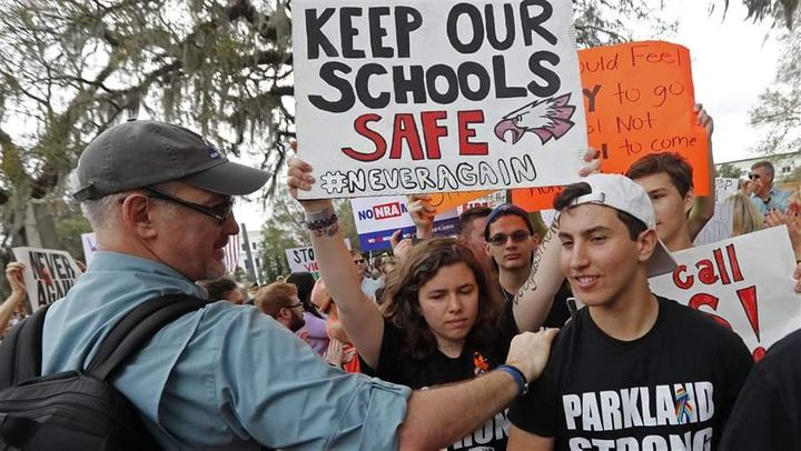 Student survivors from Marjory Stoneman Douglas High School are greeted as they arrive at a rally for gun control reform on t