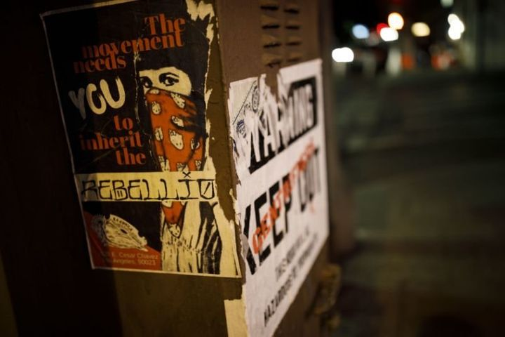 "Posters on a Boyle Heights, Los Angeles, utility box state, ""The Movement Needs You To Inherit The Rebellion"" and"