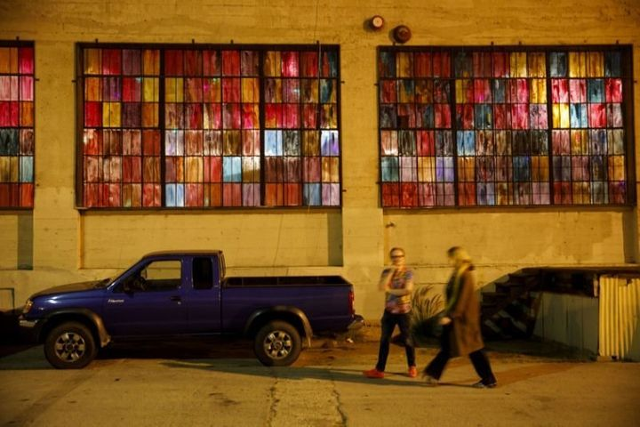Pedestrians walk past the 356 Mission art gallery in Boyle Heights.