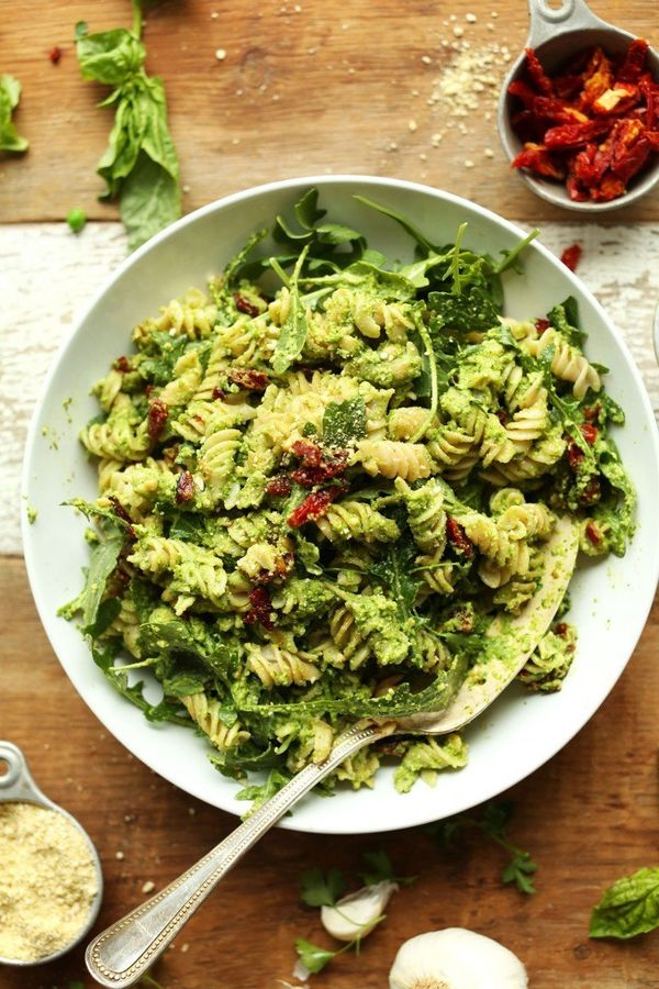 "<strong>Get the <a href=""https://minimalistbaker.com/pea-pesto-pasta-with-sun-dried-tomatoes-arugula-vegan-gf/"" target=""_blan"