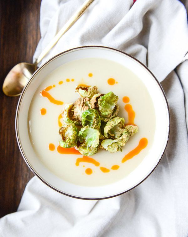 "<strong>Get the <a href=""https://www.howsweeteats.com/2015/01/creamy-roasted-garlic-potato-soup-with-crispy-brussels-chili-oi"