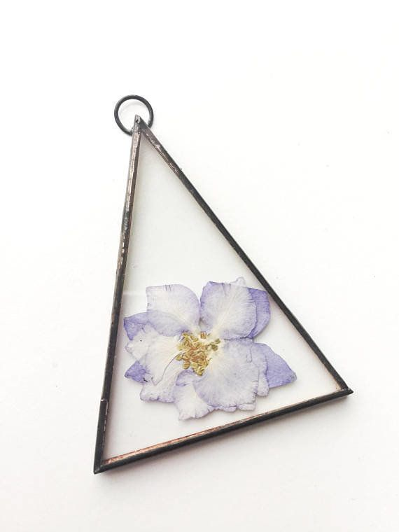 """Get it from <a href=""""https://www.etsy.com/listing/579175666/glass-pressed-flower-frame-triangle?ga_order=most_relevant&ga"""